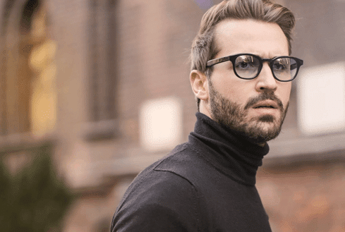 A man with glasses and turtleneck