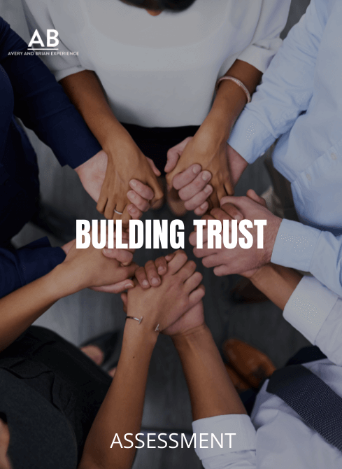 A group of people holding hands in a circle - Building Trust