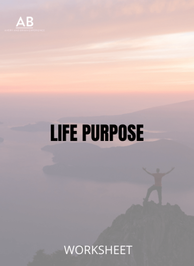 Man standing in victory position on the peak of a mountain - Life Purpose